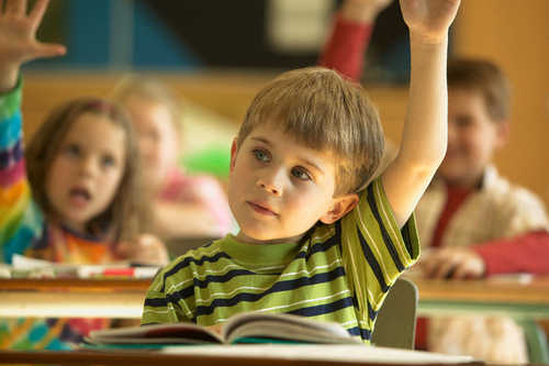 Students with Raised Arms in Classroom --- Image by © LWA-Dann Tardif/zefa/Corbis